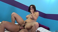 Busty Krissy Lynn teases in bed and then hops on to ride his prick