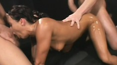 Slutty brunette oils up her superb body and gets deeply double drilled