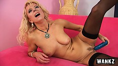 Broad-minded petticoat Marylin penetrates her sweet cooze with blue phallus
